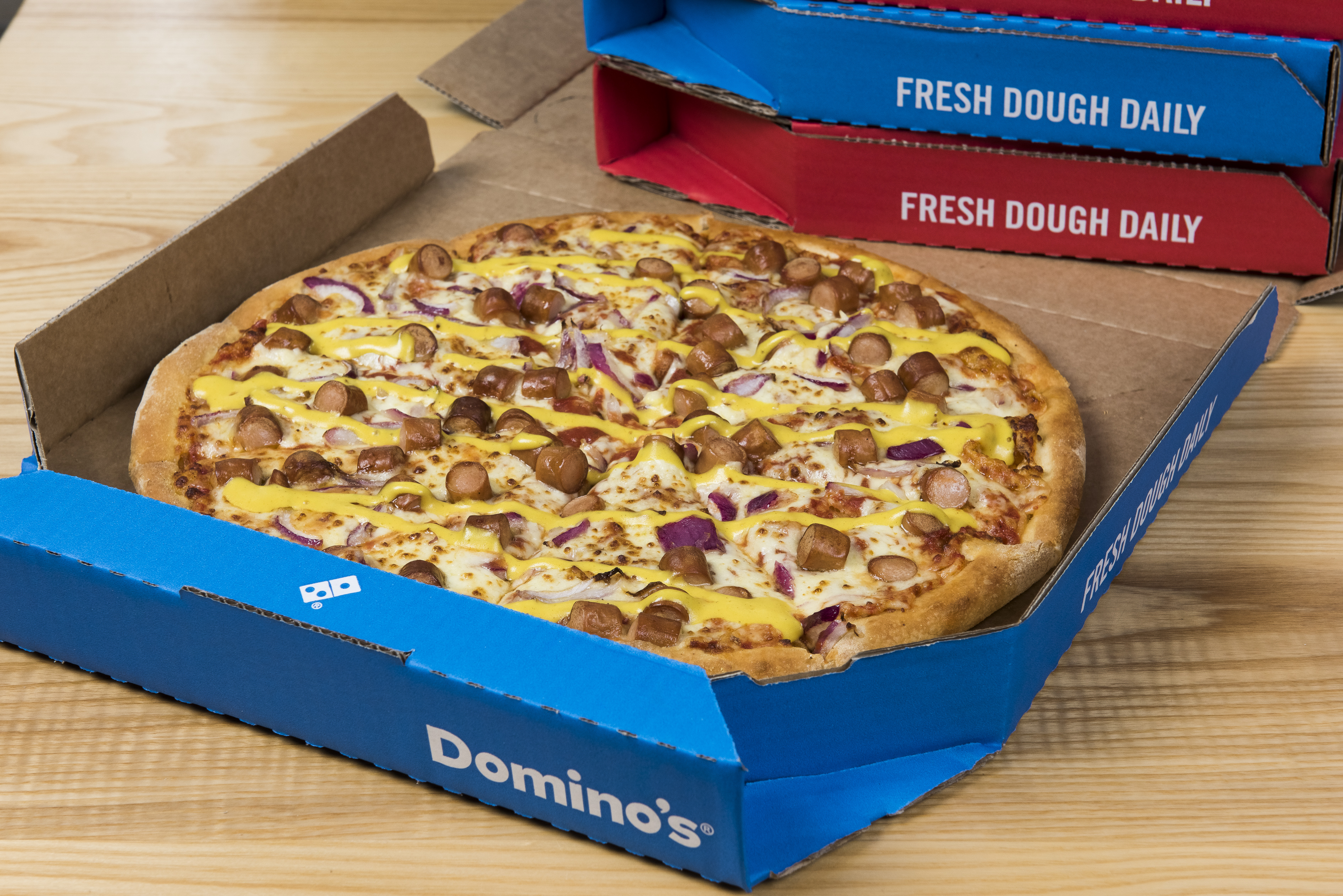 Domino's Launches the New York Hot Dog Pizza | Feast Magazine