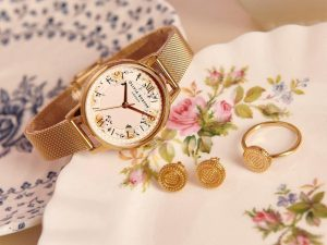 Tea Party watch and biscuit jewellery in gold.